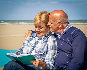 old couple with photo album