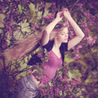 Beautiful woman and flowering tree. Beauty young girl in the flo