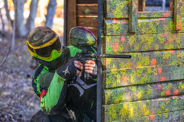 shooter behind fortification with paint splashes