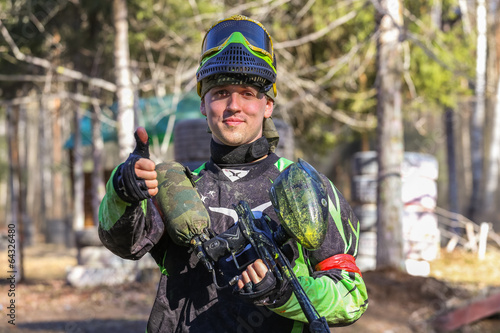 Smiling sportsman shows his thumb