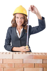 Woman builder measuring isolated on the white