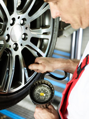 Close up of checking tire pressure