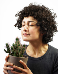 Woman smells a cactus