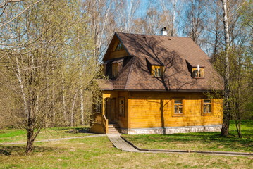 Small wooden house in the spring forest