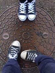 standing on a manhole