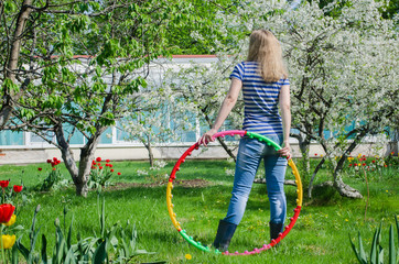 woman hold colorful hula hoop nature background