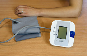 hands and digital blood pressure measurement