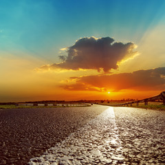 fantastic sunset over asphalt road