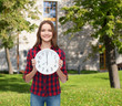 young woman in casual clothes with wall clock