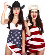 Two Ecstatic Showy Women Wrapped in USA Flag