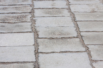 sidewalk in gray colors with cobblestones in the city