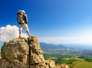 Tourist on the rock. Sport and active life concept