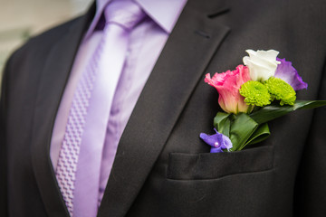Groom with flower in the lapel of his jacket