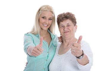 Jung und Alt: zwei Frauen isoliert mit Daumen hoch