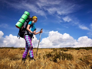 Tourist in the mountain valley. Sport and active life concept