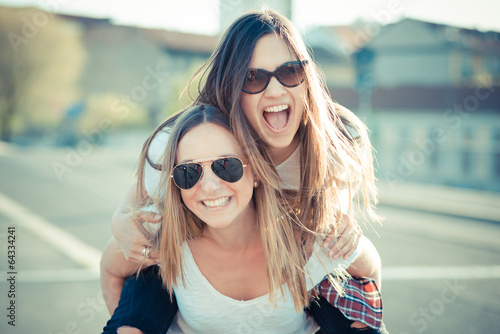 two beautiful young women having fun