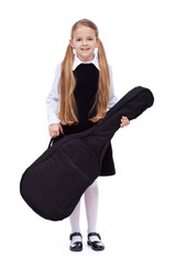Learning to play a musical instrument - little girl with guitar