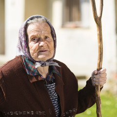 Old woman with garden tools