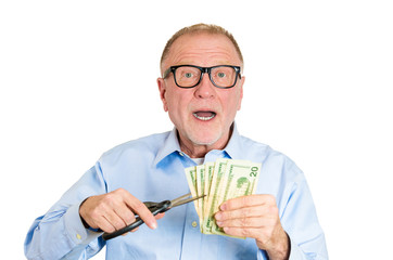 Cut your expense concept. Senior man planning on budget