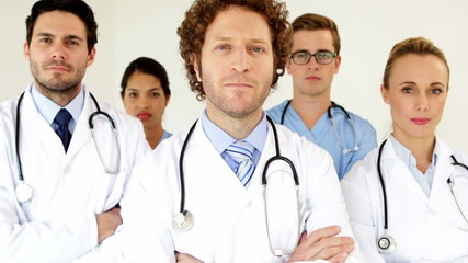 Medical team looking at the camera with arms crossed