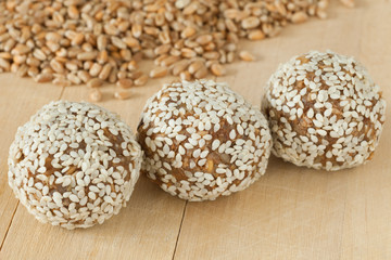 balls from ground wheat sprouts with sesame seeds