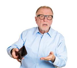 Sad, gloomy, surprised elderly man holding empty wallet