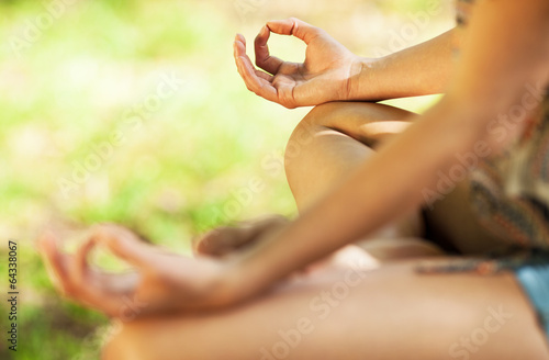 Tuinposter Ontspanning Young female meditate in nature.Close-up image.