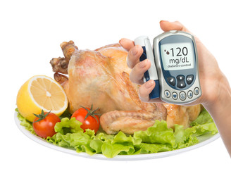Diabetes concept glucose meter  garnished roasted chicken meal