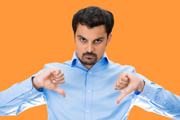 Angry Man giving Thumbs down, isolated  orange background