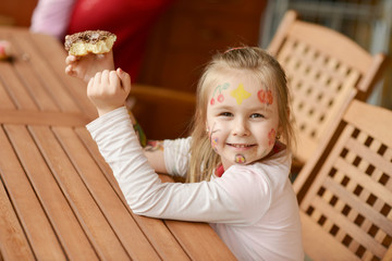 Picture of funny little girl with colorful donuts