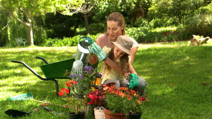 Little girl gardening with her mother