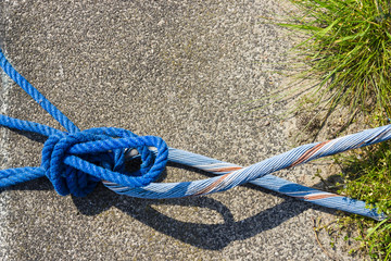 Blue Rope And Knot On asphalt Background