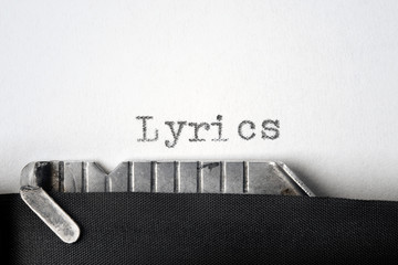 """Lyrics"" written on an old typewriter. Closeup."