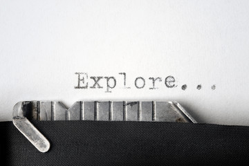 """Explore..."" written on an old typewriter. Closeup."