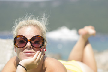 Happy woman sunbathing (sunglasses, vacation, holidays)