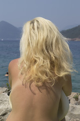 Blonde woman sunbathing - (back, topless, tan, hat, ocean)