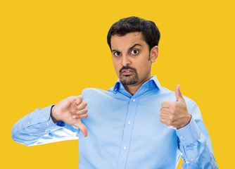 Confused man with Thumbs up or down? yellow background