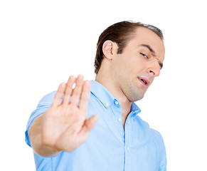Offended man gives talk to the hand gesture on white background