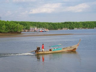 Sailing long-tailed boat on a river in Thailand