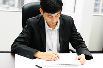 Businessman working at desk at office