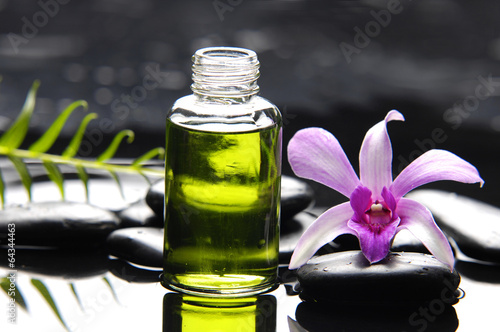 Poster Spa Pink orchid with pebbles and massage oil ,fern