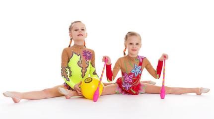 Two pretty little girl doing gymnastics
