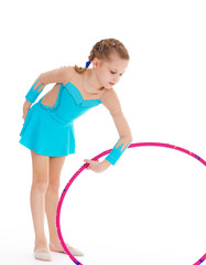 Beautiful little gymnast with the hoop