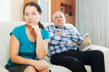 Upset mature woman against elderly man