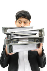 Businessman in suit with binder in hands