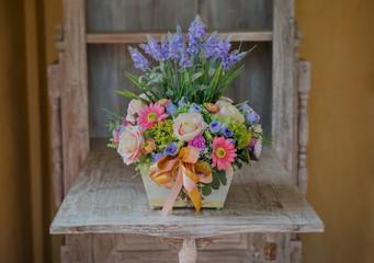 flowers in basket on  the vintage desk