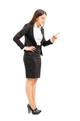 Angry female boss threatening with finger