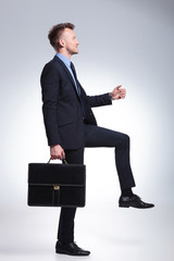 business man steps with briefcase
