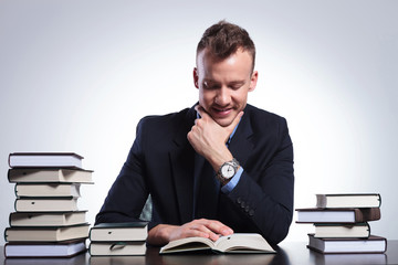 business man reads interesting book