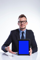 business man presents his tablet